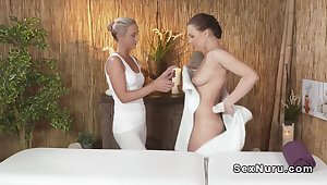 Blonde masseuse well off and rubbing brunette