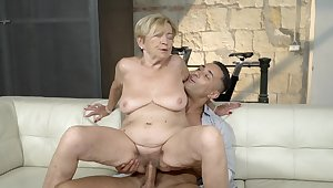 Old lady feels great anent a massive young flannel inside her pussy